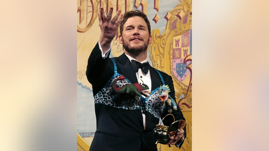 Feb 6. 2015. While dressing in a bra adorned with stuffed animals, actor Chris Pratt thanks the crowd during a roast at Harvard University, in Cambridge, Mass