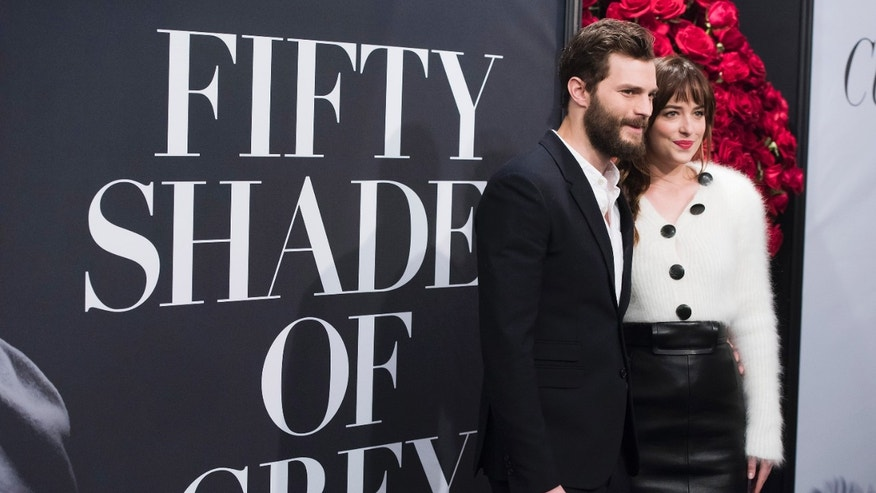 "Feb 6, 2015. Jamie Dornan and Dakota Johnson attend a special fan screening of  ""Fifty Shades of Grey"" at the Ziegfeld Theatre in New York."