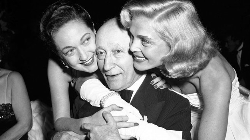 Jan. 7, 1953: Adolph Zukor, gets birthday hugs from Dorothy Lamour, left, and Lizabeth Scott at film industry dinner in the Hollywood section of Los Angeles.