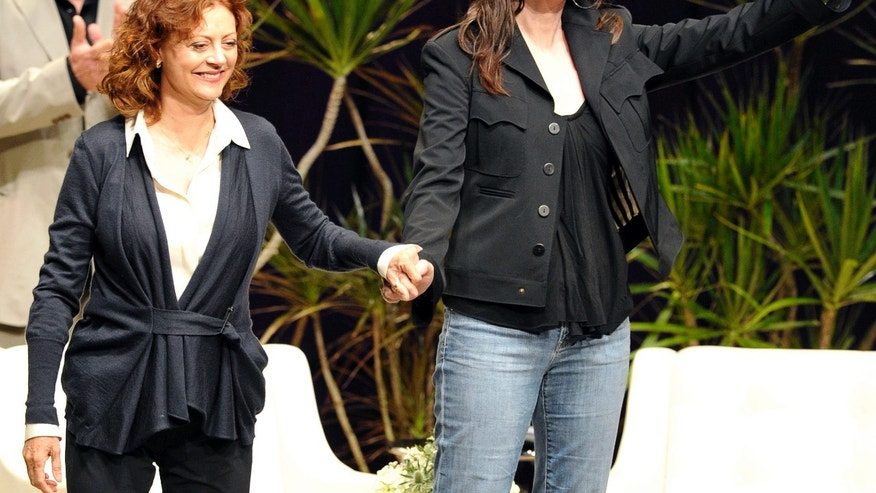 "June 7, 2011. Susan Sarandon and Geena Davis (R) arrive on stage for the 20th anniversary celebration of the film ""Thelma & Louise,"" in Toronto."