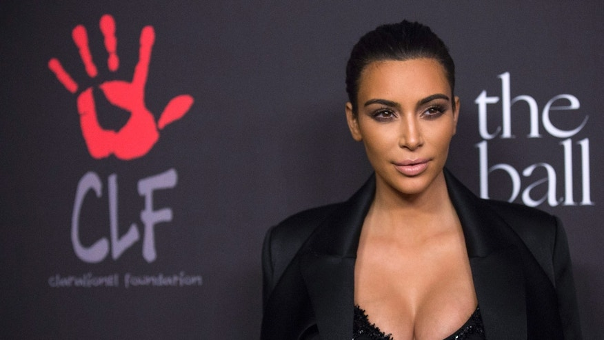 Dec 11, 2014. Television personality Kim Kardashian poses at the First Annual Diamond Ball fundraising event at The Vineyard in Beverly Hills, California.