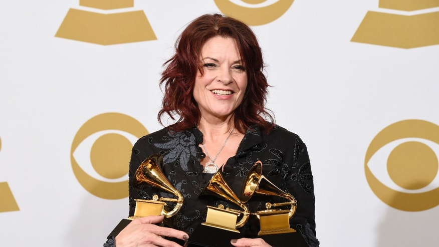 Rosanne Cash poses in the press room with the awards for best American roots performance for A Feather's Not A Bird, best American roots song for A Feather's Not A Bird and best Americana album for The River & The Thread at the 57th annual Grammy Awards at the Staples Center on Sunday, Feb. 8, 2015, in Los Angeles. (Photo by Chris Pizzello/Invision/AP)