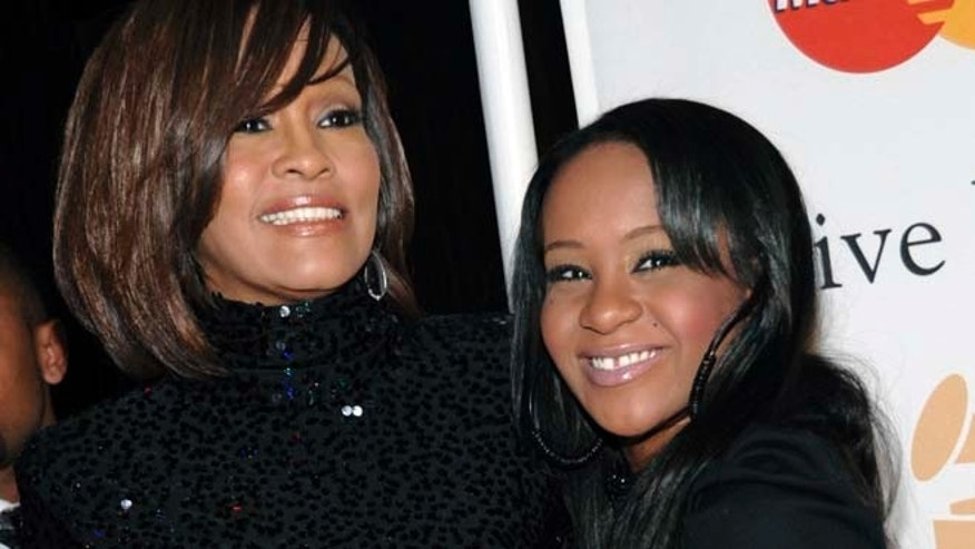 Feb. 12, 2011: In this file photo, singer Whitney Houston, left, and daughter Bobbi Kristina Brown arrive at an event in Beverly Hills, Calif. (AP)