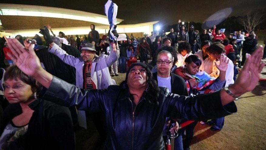 Feb. 9, 2015: Denice Matthews of Riverdale, Ga., joins several hundred people at the Riverdale amphitheater for a prayer vigil for Bobbi Kristina Brown. (AP Photo/Atlanta Journal-Constitution, Ben Gray)