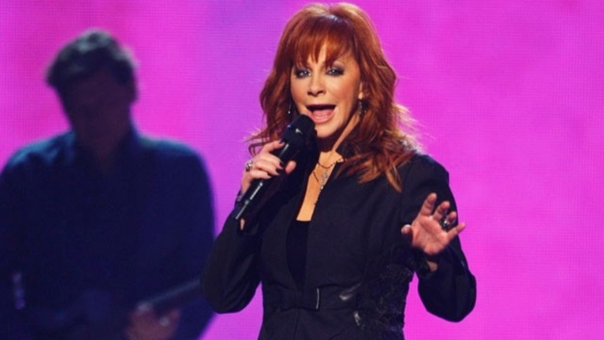 "Reba McEntire performs ""When Love Gets a Hold of You"" at the 46th annual Academy of Country Music Awards in Las Vegas April 3, 2011.  REUTERS/Steve Marcus (UNITED STATES - Tags: ENTERTAINMENT)"