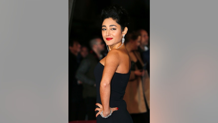 "Cast member Golshifteh Farahani poses as she arrives for the film world premiere of ""Exodus: Gods and Kings"" at the Odeon Leicester Square in central London, December 3, 2014. REUTERS/Suzanne Plunkett (BRITAIN - Tags: ENTERTAINMENT) - RTR4GLQJ"