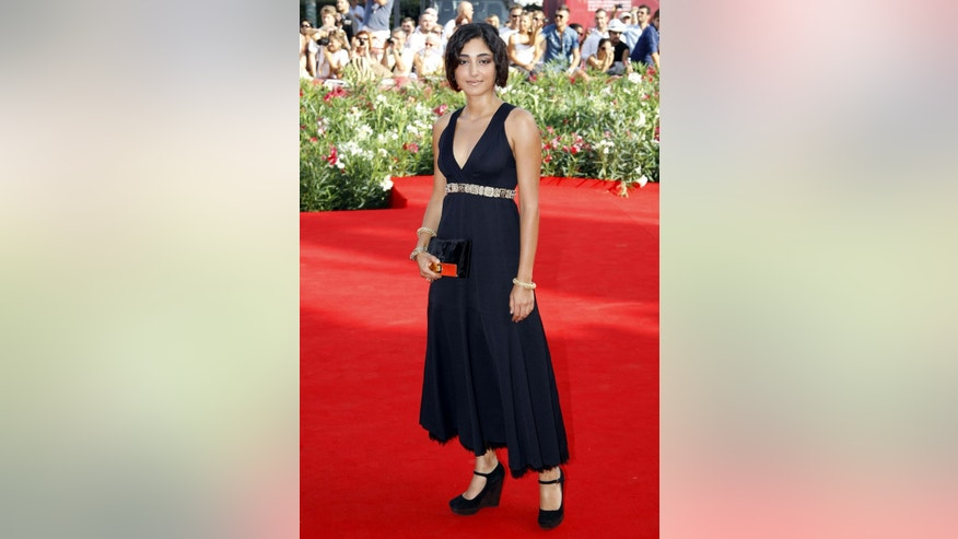 "Actress Golshifteh Farahani poses for photographers on the ""Poulet Aux Prunes"" red carpet at the 68th Venice Film Festival September 3, 2011. REUTERS/Alessandro Garofalo (ITALY - Tags: ENTERTAINMENT) - RTR2QQP9"