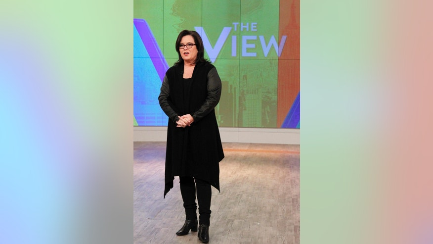 "In this Jan. 29, 2015 photo released by ABC, co-host Rosie O'Donnell appears on the ""The View,"" in New York. O'Donnell has ended her second stint on ""The View,"" her goodbye about as short as her tenure. Holding her toddler daughter, she made her exit Thursday, Feb. 12, in a brief segment. She thanked the show's creator, Barbara Walters, and promised to bring her glue gun back someday for a crafting segment. She had returned to ""The View"" in September, part of a revamp aimed at stopping a ratings slide, joining Whoopi Goldberg, Rosie Perez and Nicolle Wallace on the panel. (AP Photo/ABC, Lou Rocco)"
