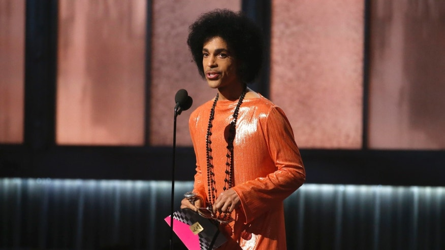 February 8, 2015. Prince presents the award for album of the year at the 57th annual Grammy Awards in Los Angeles, California.