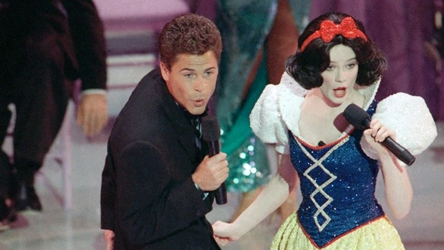 March 30, 1989. Rob Lowe croons a tune to Snow White during the opening number for the 61st Academy Awards presentation in Los Angeles.