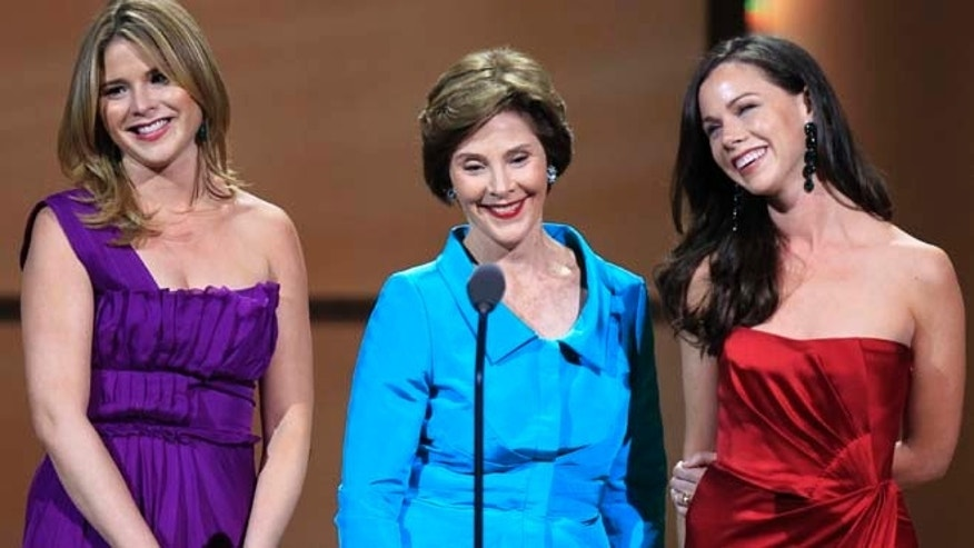 Former U.S. First Lady Laura Bush (C) speaks with her daughters Jenna Bush Hager (L) and Barbara Bush as they accept the Woman of the Year award during the 21st annual Glamour Magazine Women of the Year award ceremony in New York November 7, 2011. REUTERS/Lucas Jackson (UNITED STATES - Tags: ENTERTAINMENT POLITICS) - RTR2TQIC