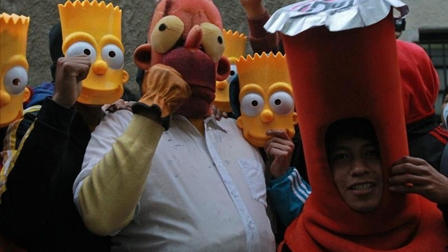 Young Bolivians participate in a demonstration to demand the reinstatement of the television series The Simpsons on February 6, 2015, in La Paz, Bolivia.