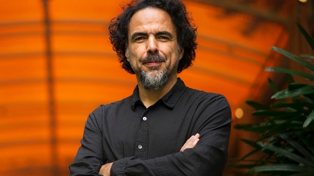 """FILE - In this Wed., Dec. 17, 2014 file photo, Alejandro Gonzalez Inarritu, director of the film """"Birdman,"""" poses for a portrait at the Four Seasons Hotel in Los Angeles. """"Birdman"""" is looking to drop another trophy into its nest ahead of the Academy Awards. After taking top honors from the acting and producing guilds, the film featuring Michael Keaton as a former superhero film star faces one last flight at the Directors Guild Awards on Saturday, Feb. 7, 2015, in Los Angeles. (Photo by Chris Pizzello/Invision/AP, File)"""