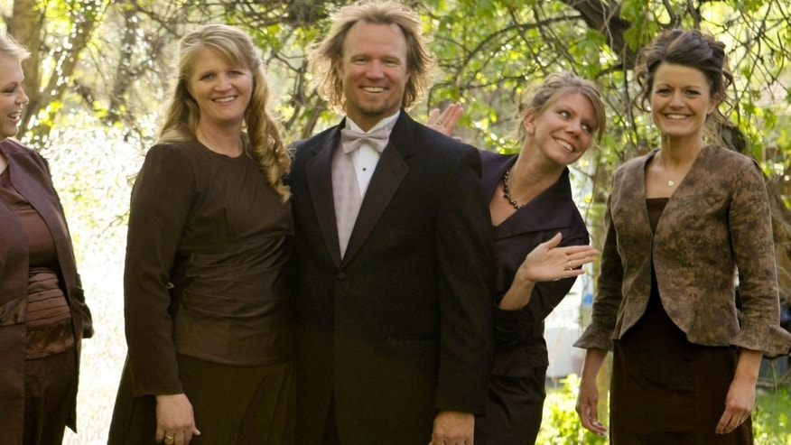 "Kody Brown, center, poses with his wives, from left, Janelle, Christine, Meri, and Robyn in a promotional photo for TLC's reality TV show, ""Sister Wives."""