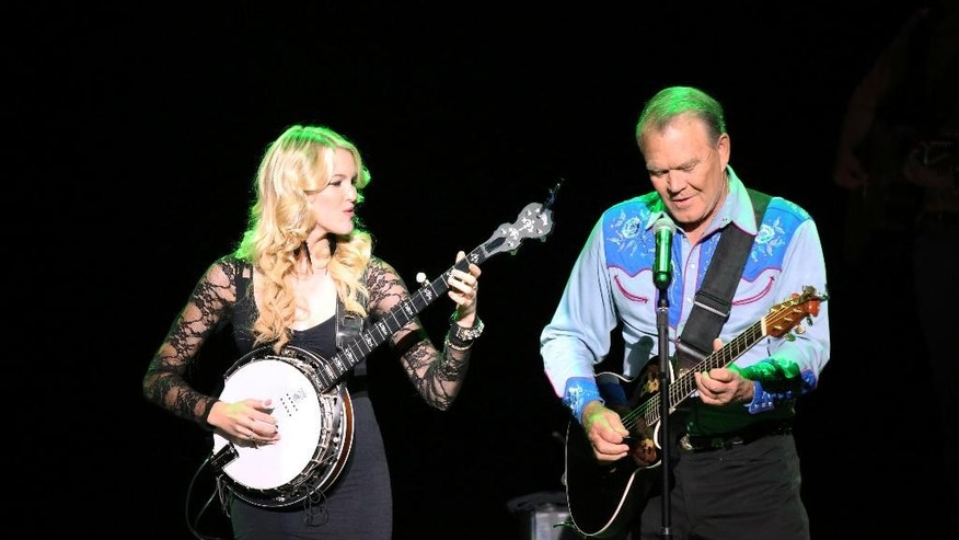 "Ashley Campbell, left, and Glen Campbell performing during ""The Goodbye Tour,"" in a scene the documentary film, ""Glen Campbell... I'll Be Me."""
