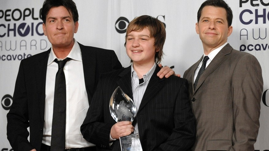 "FILE - In this Jan. 7, 2009 file photo, from left, Charlie Sheen, Angus T. Jones and Jon Cryer, pose for a picture backstage with their favorite TV comedy award for ""Two and a Half Men"" at the 35th Annual People's Choice Awards in Los Angeles."