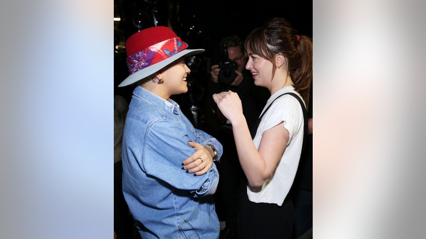 Feb 20, 2015. Rita Ora, left, and Dakota Johnson speak with each other backstage during rehearsals for the 87th Academy Awards in Los Angeles.