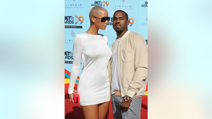 June 28, 2009. Rapper Kanye West poses with Amber Rose while arriving at the BET Awards in Los Angeles.