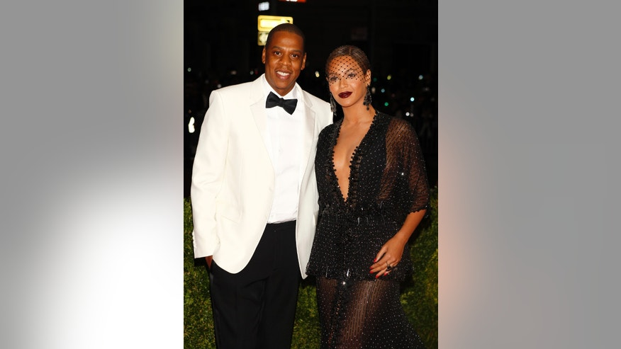May 5, 2014. Rapper Jay Z and singer Beyonce Knowles arrive at the Metropolitan Museum of Art Costume Institute Gala Benefit in New York.