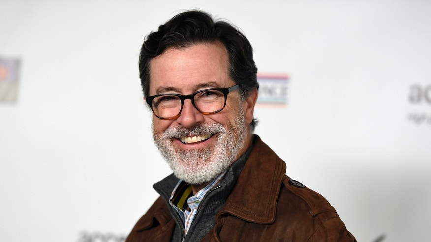 February 19, 2015. Honoree Stephen Colbert poses at the Oscar Wilde Awards at director J.J. Abrams' Bad Robot production company in Santa Monica, California.