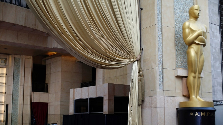 February 20, 2015. An Oscar statue is pictured outside the Dolby theater during preparations leading up to the 87th Academy Awards in Hollywood, California.