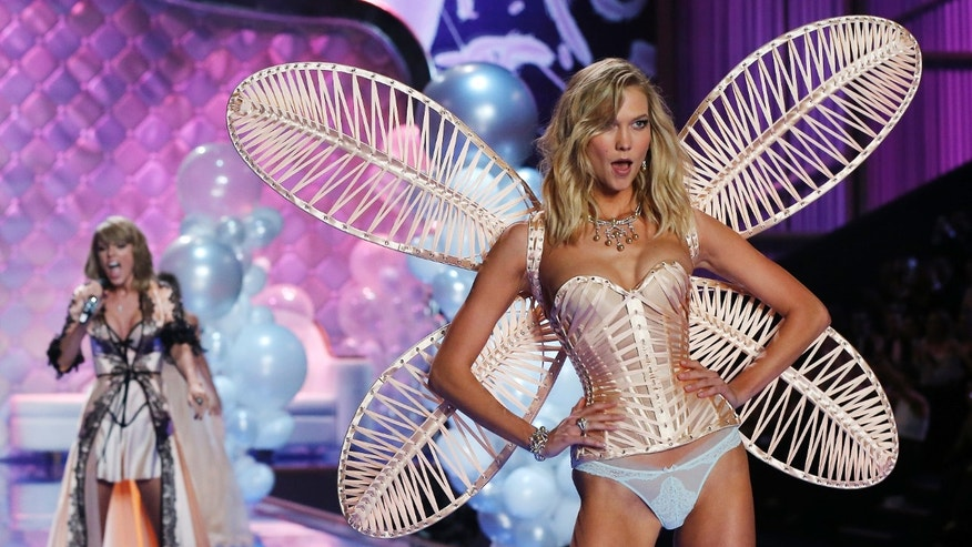 December 2, 2014. Singer Taylor Swift (L) performs as model Karlie Kloss presents a creation during the 2014 Victoria's Secret Fashion Show in London.