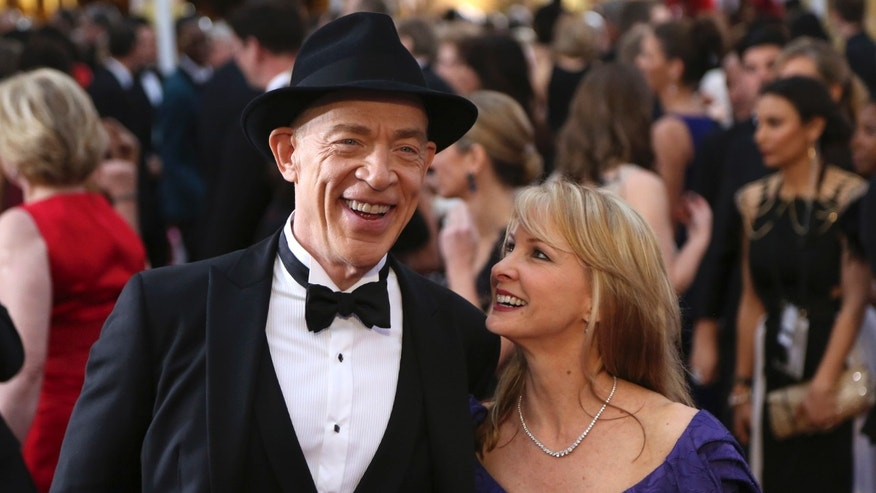"J.K. Simmons, best supporting actor nominee for his role in ""Whiplash"" and his wife Michelle Schumacher arrive at the 87th Academy Awards in Hollywood, California February 22, 2015.   REUTERS/Robert Galbraith (UNITED STATES  - Tags: ENTERTAINMENT)  (OSCARS-ARRIVALS) - RTR4QO4L"