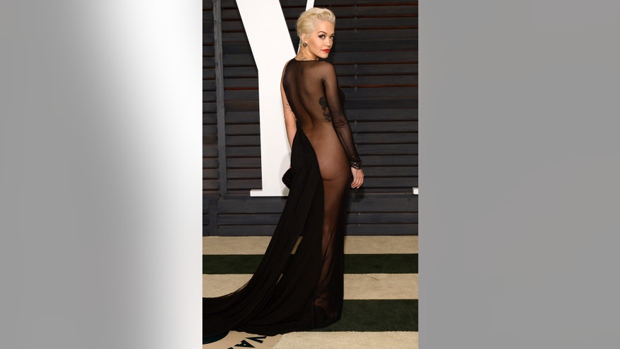 Rita Ora showed way too much skin at Vanity Fair's Oscars Party. The black Donna Karan dress' oddly placed bow did not flatter the singer at all.