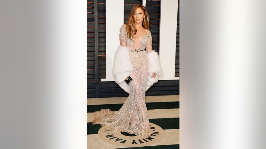 Nobody upstages Jenny from the block. Lopez looked flawless in her sparkly gown and fur shawl.