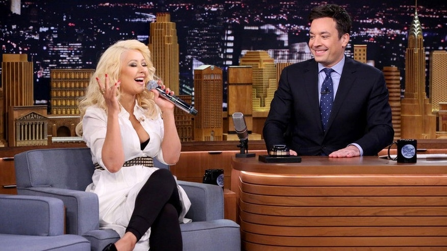 Christina Aguilera and host Jimmy Fallon play Wheels of Impressions on February 23, 2015.