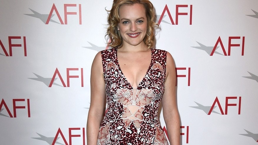 FILE - In this Jan. 9, 2015 file photo, Elisabeth Moss arrives at the AFI Awards at The Four Seasons Hotel in Los Angeles.