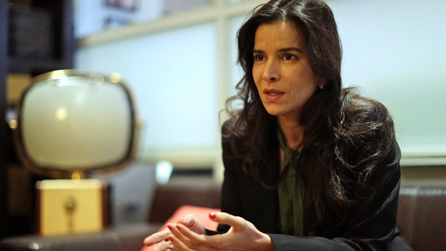 "Venezuelan model-actress Patricia Velasquez gestures during an interview onTuesday, Feb. 10, 2015, in New York to promote her book, ""Straight Walk: A Supermodel's Journey to Finding Her Truth."""