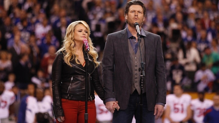 "Miranda Lambert and her husband Blake Shelton sing ""America the Beautiful"" before the start of the NFL Super Bowl XLVI football game between the New York Giants and the New England Patriots in Indianapolis, Indiana, February 5, 2012.   REUTERS/Jeff Haynes (UNITED STATES  - Tags: SPORT FOOTBALL) - RTR2XDMZ"