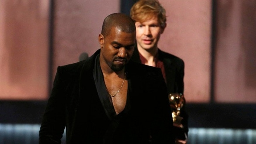 Feb. 8, 2015: Kanye West leaves the stage after pretending to take Beck's Grammy Award for album of the year at the Staples Center in Los Angeles (Reuters)
