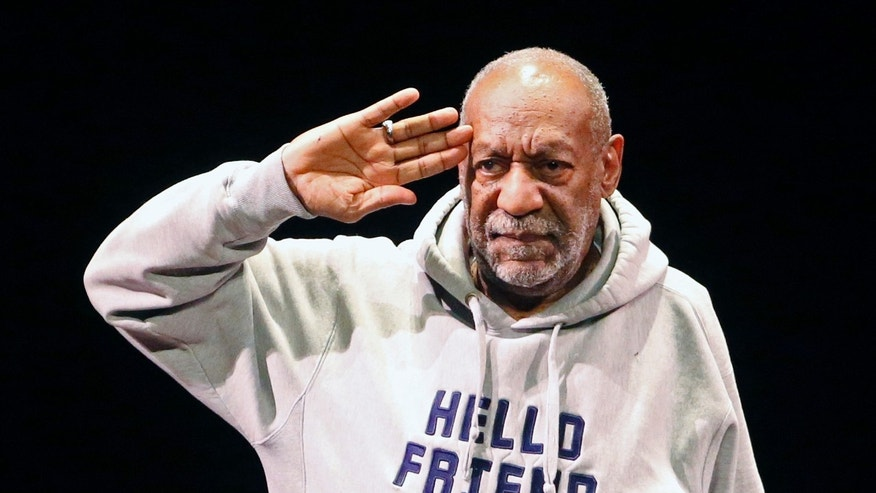 Jan. 17, 2015. Bill Cosby salutes the crowd as he begins a performance at the Buell Theater in Denver.