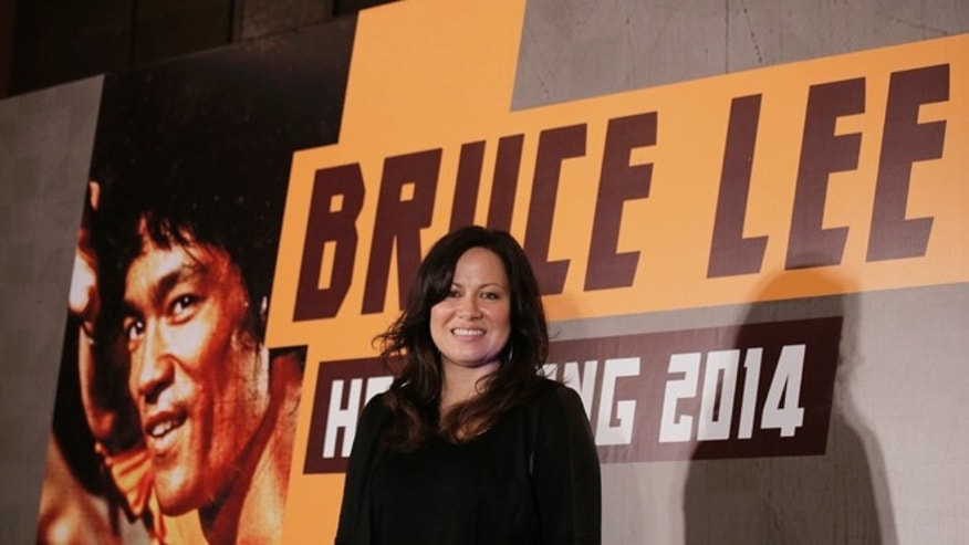 Nov. 24, 2014. Shannon Lee, daughter of Bruce Lee and president of the Bruce Lee Foundation, poses for photographers during a press conference launching instant drinks in her father's name in Hong Kong.