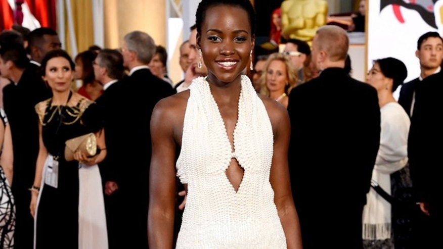 Feb. 22, 2015: Actress Lupita Nyong'o arrives at the Oscars wearing a dress made of pearls at the Dolby Theatre in Los Angeles.  (AP)