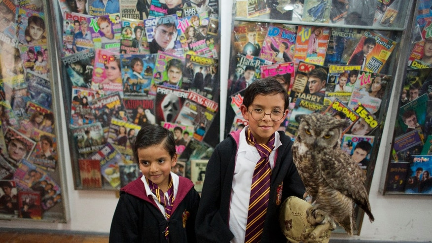 Feb 27, 2015. Harry Potter fans Mateo Lara, 5, right, and his brother Francisco, 7, pose for photos with a live owl inside an exhibition of the Guinness World Record holding collection of Harry Potter memorabilia, at the Mexican Museum of Antique Toys, in Mexico City.