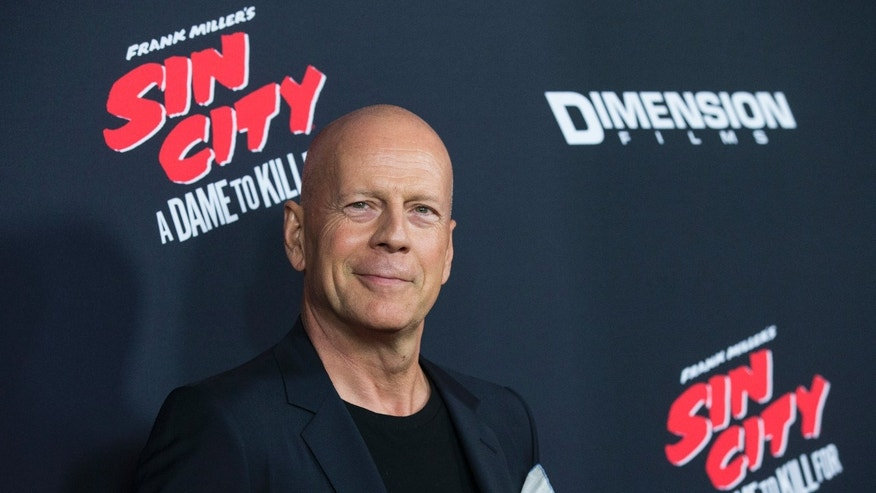 "Cast member Bruce Willis poses at the premiere of ""Sin City: A Dame to Kill For"" in Hollywood, California."