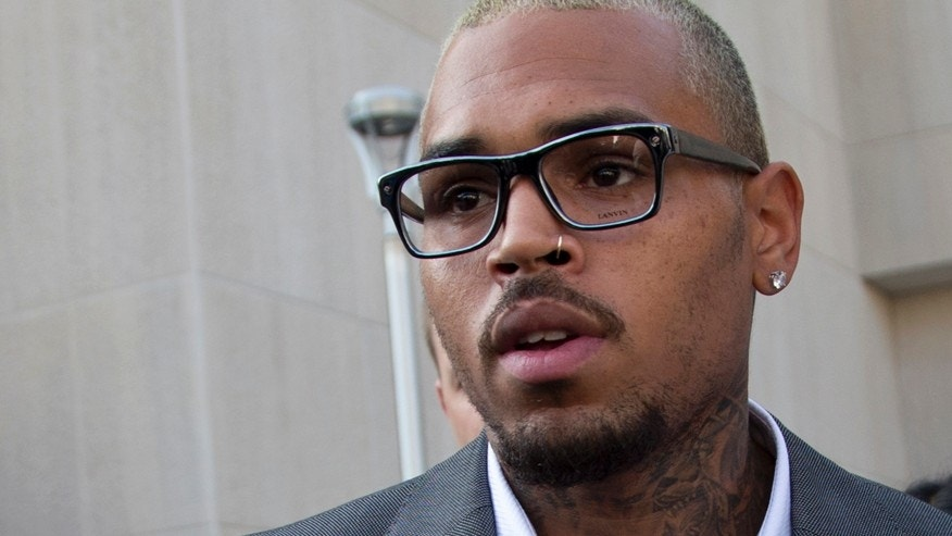 Singer Chris Brown leaves District of Columbia Superior Court in Washington, Tuesday, Sept. 2, 2014, after pleading guilty on a misdemeanor assault.