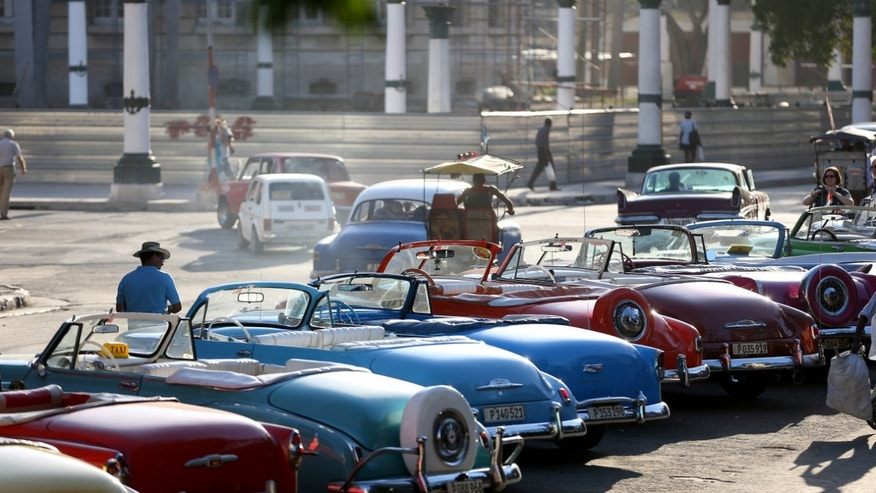 HAVANA, CUBA - FEBRUARY 28:  Vintage American automobiles are seen on the street as their owners wait for tourists wanting a ride a day after the second round of diplomatic talks between the United States and Cuban officials took place in Washington, DC on February 28, 2015 in Havana, Cuba.  The dialogue is an effort to restore full diplomatic relations and move toward opening trade.  (Photo by Joe Raedle/Getty Images)