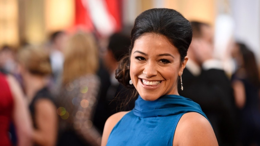 Gina Rodriguez arrives at the Oscars on Sunday, Feb. 22, 2015, at the Dolby Theatre in Los Angeles. (Photo by Chris Pizzello/Invision/AP)