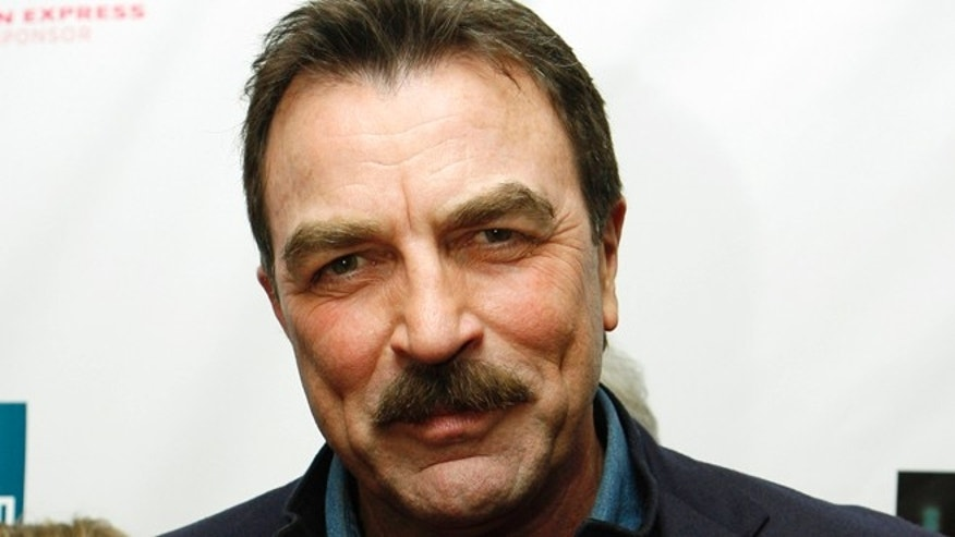 """Actor Tom Selleck is pictured during arrivals for the world premiere of the film """"United 93"""" at New York's Ziegfeld Theatre, Tuesday, April 25, 2006. The film documents United Airlines flight 93 which was hijacked and crashed by terrorists in the Pennsylvanian countryside on Sept 11, 2001. (AP Photo/Stuart Ramson)"""