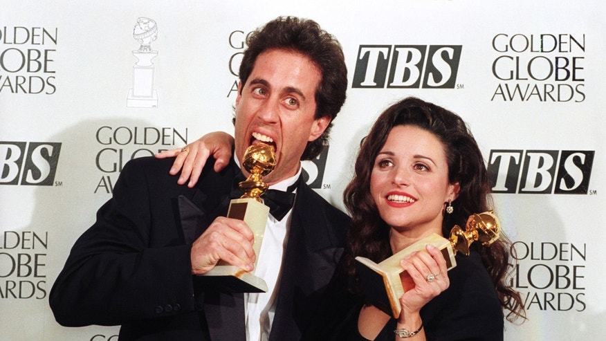 "Jerry Seinfeld and Julia Louis-Dreyfus show their Golden Globe awards January 22, 1994. Seinfeld won best actor in a comedy television series and Louis-Dreyfus won best supporting actress for ""Seinfeld,"" which also won best comedy series.  REUTERS/Sam Mircovich - RTR1IZAG"