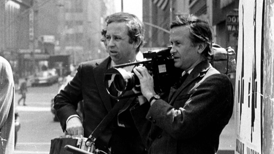 "FILE - In this July 1969 file photo, documentary filmmakers David, left, and Albert Maysles work on the streets of New York for ""Salesman."" Albert Maysles, who along with his brother David made works of cinema verite in the 1960s and 70s, including the Rolling Stones documentary Gimme Shelter, died Thursday, March 5, 2015 in New York. He was 88. His brother David Maysles died in 1987.  (AP Photo, File)"