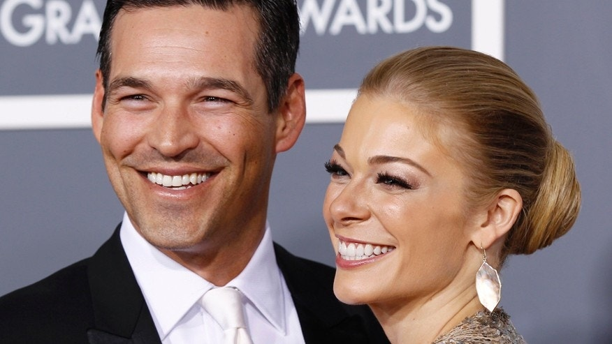 Singer LeAnn Rimes (R) and actor Eddie Cibrian arrive at the 53rd annual Grammy Awards in Los Angeles, California February 13, 2011.