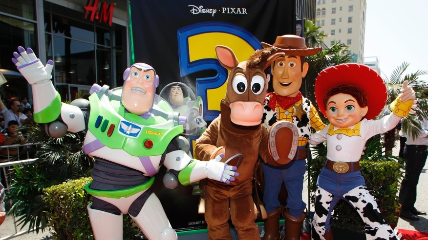 "June 13, 2010. Characters from Disney Pixar's ""Toy Story 3"" (L-R) Buzz Lightyear, Bullseye, Woody, and Jessie pose at the world premiere of the movie at the El Capitan Theatre in Hollywood, California."
