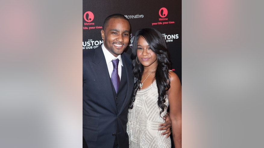 "October 22, 2012. Nick Gordon (L) and Bobbi Kristina Brown attend the opening night of &quot ""The Houstons: On Our Own"" in New York."