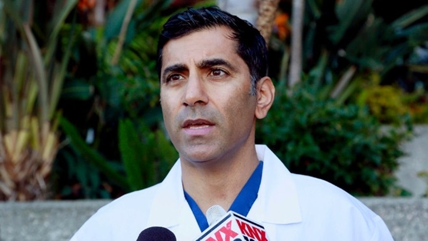 March 6, 2015. Dr. Sanjay Khurana talks to reporters, at his office in Marina Del Rey, Calif about how he saw actor Harrison Ford's plane falling from the sky while on a golf course on Thursday. Khurana was one of the first people to come to Ford's aid after the crash.