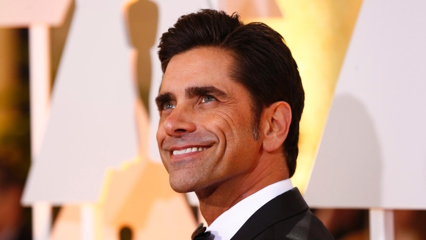 February 22, 2015. Actor John Stamos arrives at the 87th Academy Awards in Hollywood, California.